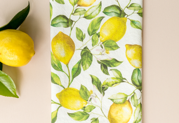 Lemon tea towel folded with lemon branch