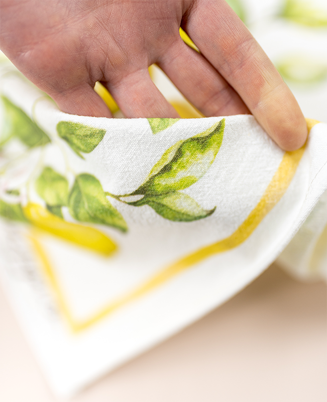 closeup of lemon tea towel fabric and printing