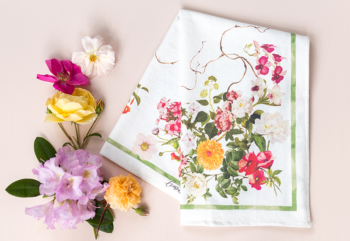 floral botanical tea towel folded with flowers