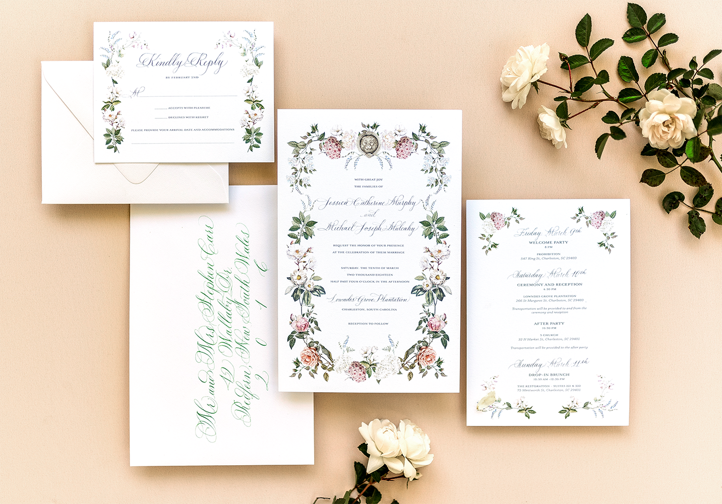 pale floral custom suite with green calligraphy envelopes and white florals