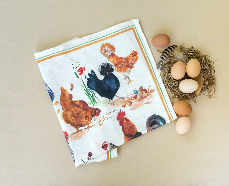 chicken tea towel folded with eggs in nest