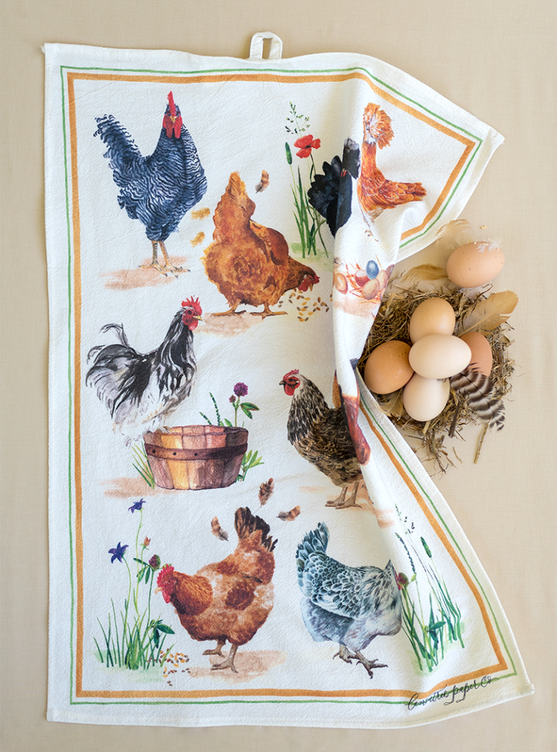 chicken tea towel outstretched with eggs in a basket and feathers
